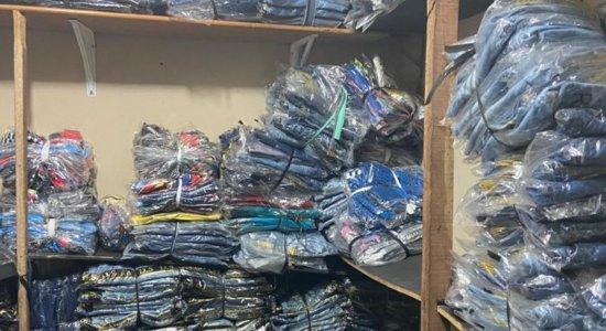 Operação da PC apreende máquinas e 30 mil etiquetas de marcas usadas na confecção de roupas falsificadas
