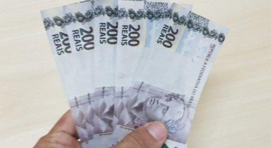 Pedreiro é preso tentando pagar peixe com notas de R$ 200 falsas em Carpina