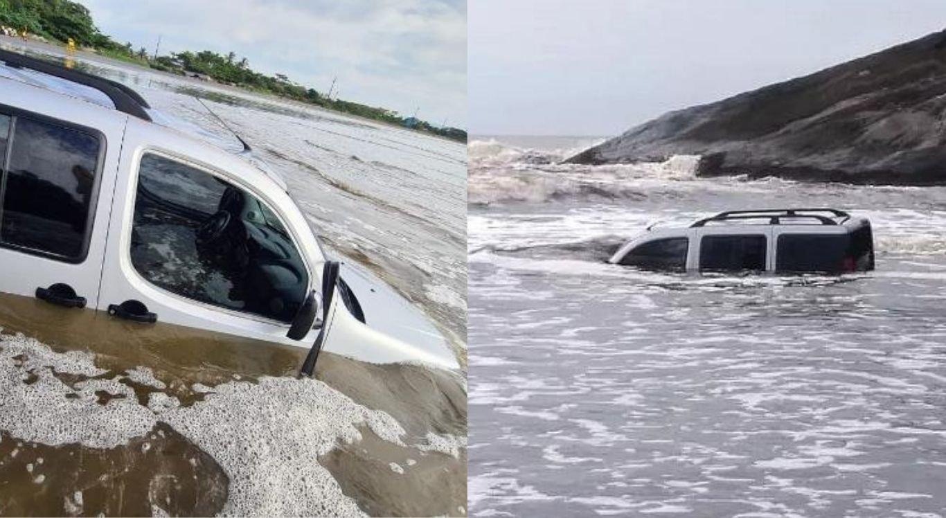 Carro ficou submerso pela água em praia do litoral de São Paulo.