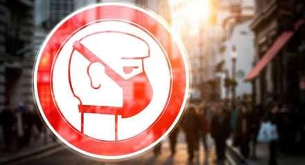 Símbolo de pessoa com máscara em alusão à pandemia do novo coronavírus