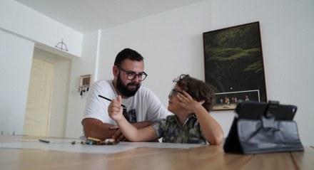 O fotógrafo Hesíodo Góes e seu filho, Otto